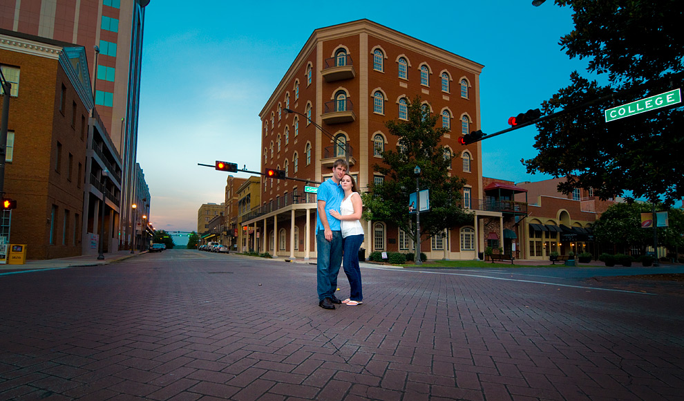 Couple standing on College Avenue in downtown Tallahassee in the evening