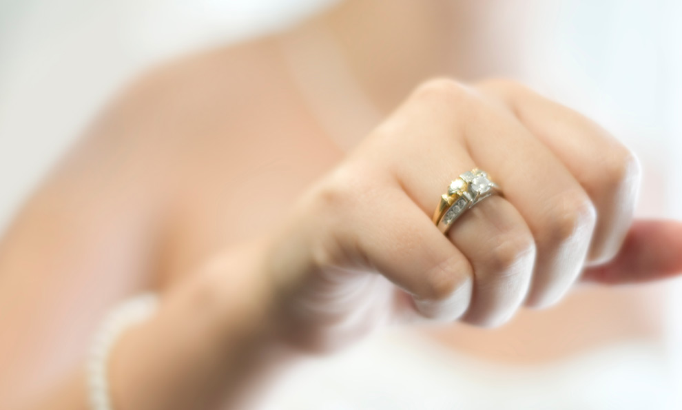 Engagement ring around bride's finger