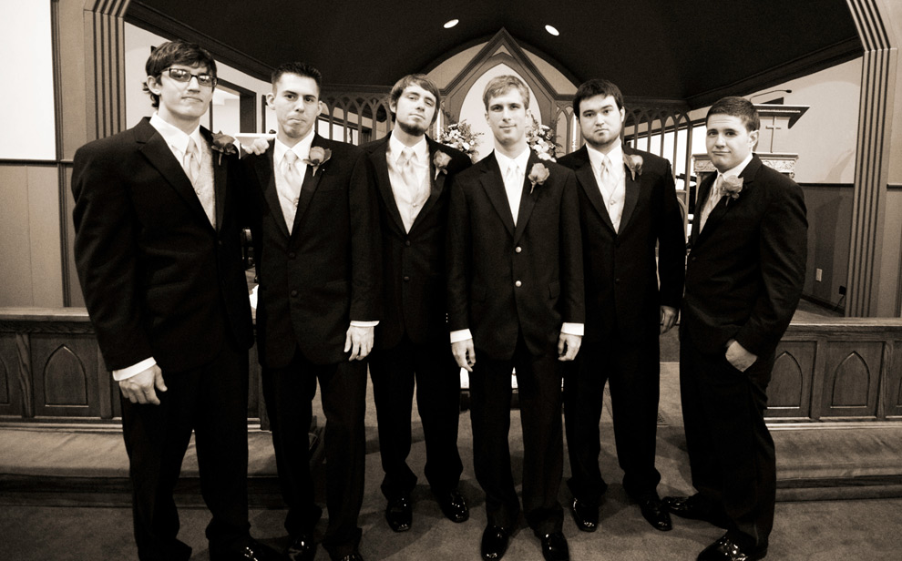 Groom and groomsmen at the altar