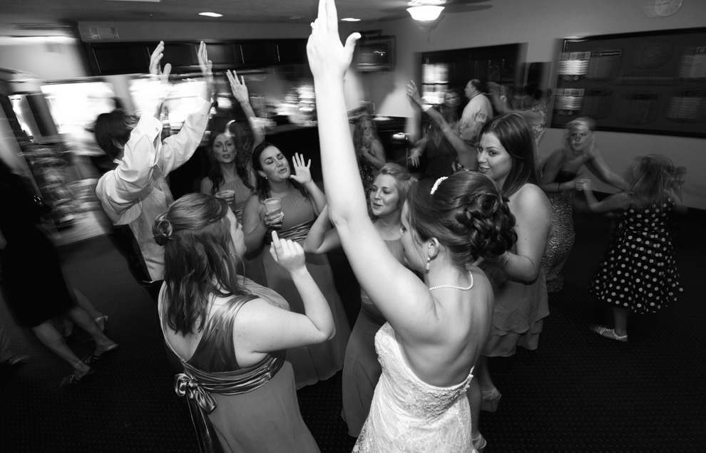 Black and white of the new bride and groom dancing