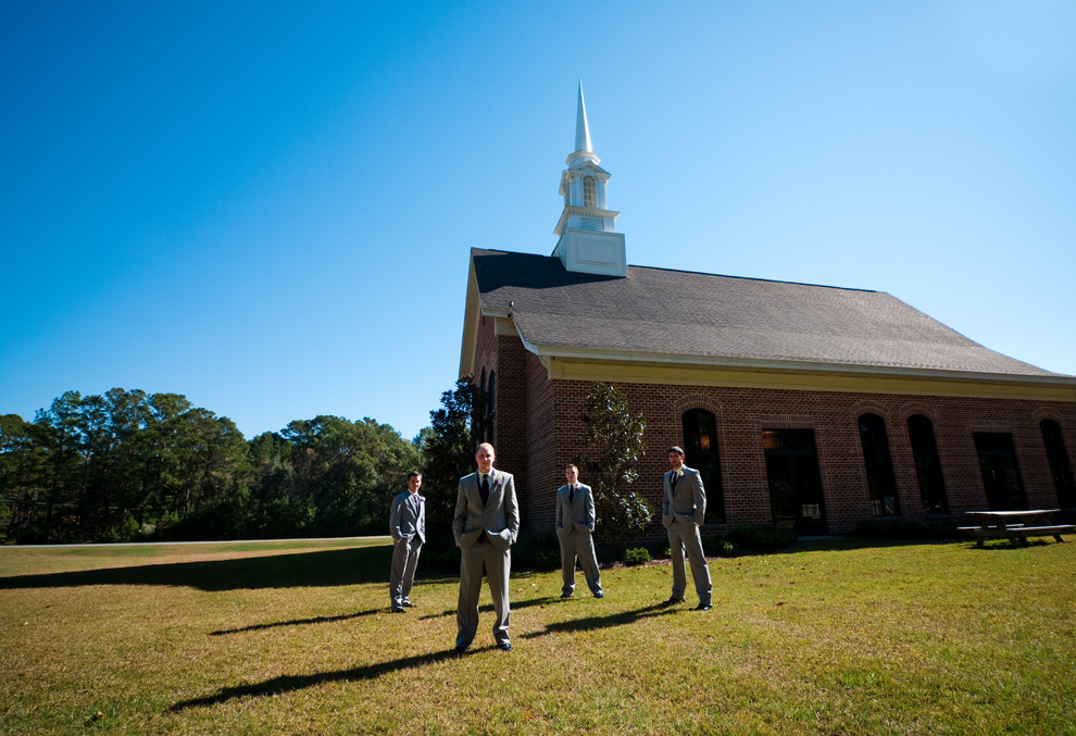 Wide shot of the groom and groomsmen outside the Trinity Community Church in Tallahassee