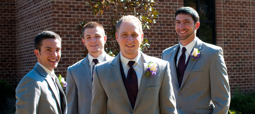 Groom and his groomsmen posing outside the church