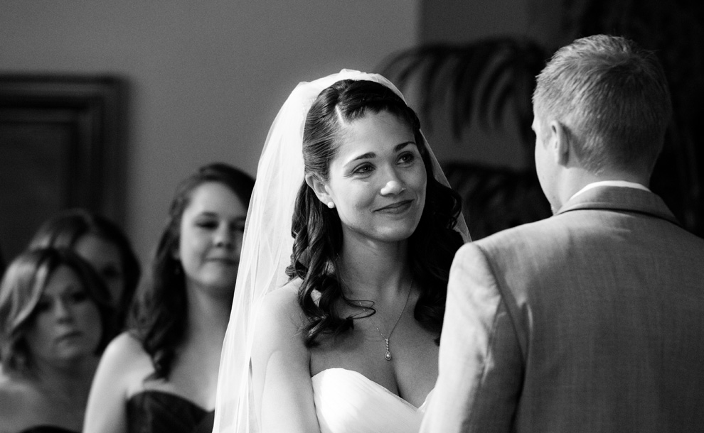 Bride smiling at her soon-to-be husband during the ceremony