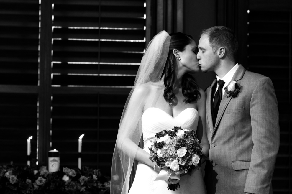 Black and white kiss of the bride and groom