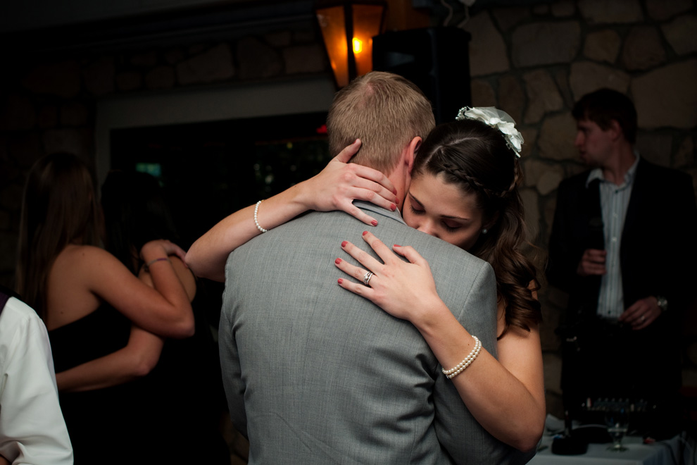 Bride and groom embrace during a slow dance