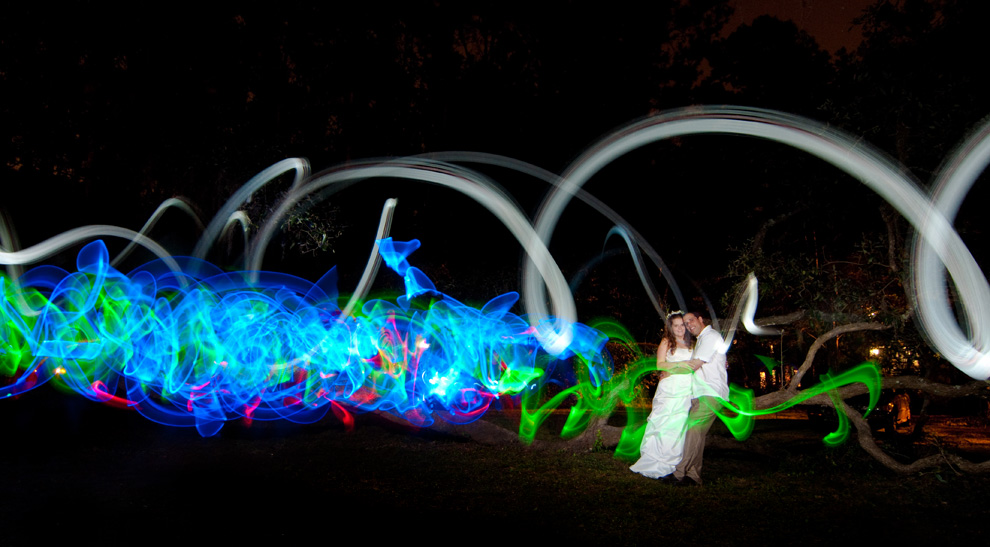 Long exposure shot with light streaks and trails, the bride and groom posing