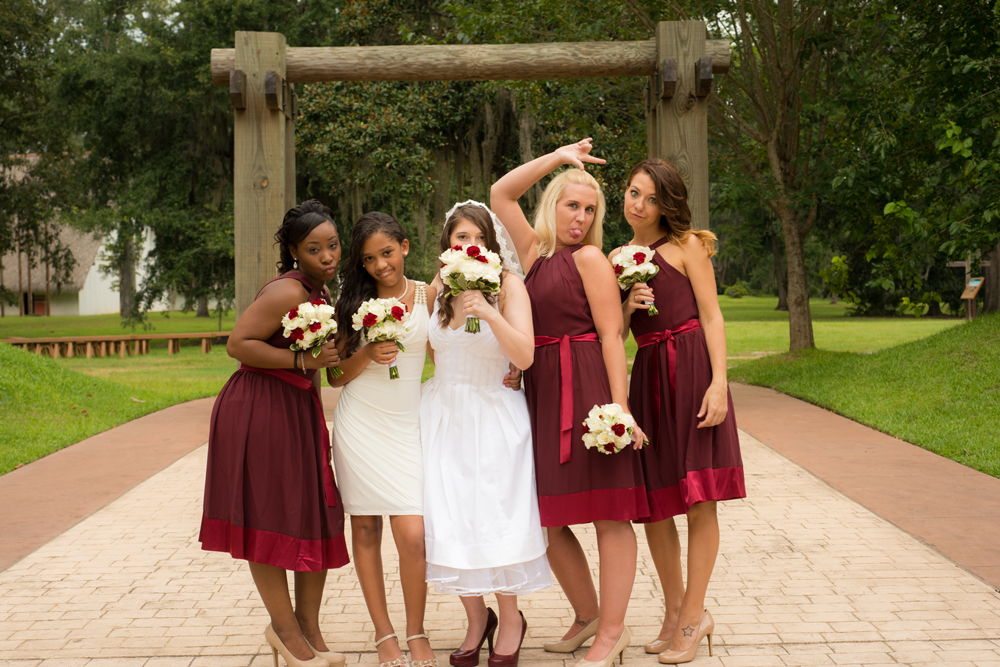The bride and her bridesmaids make goofy faces