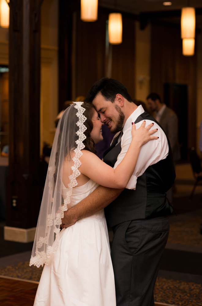 Bride and groom's foreheads touch as they dance their first dance together