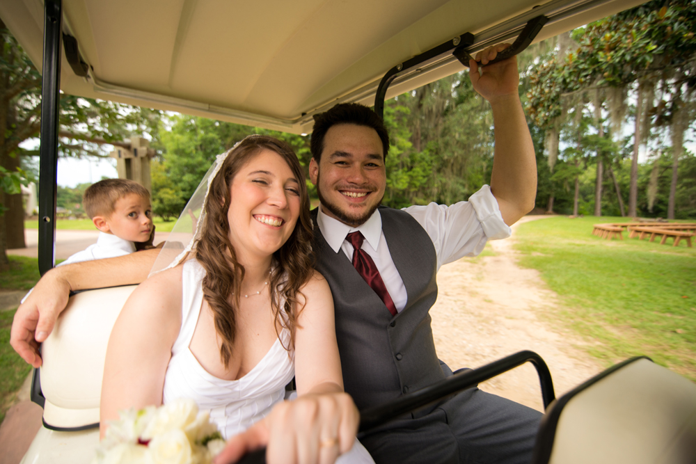 After the formal photos finished, the bride and groom rode in a golf cart to the church