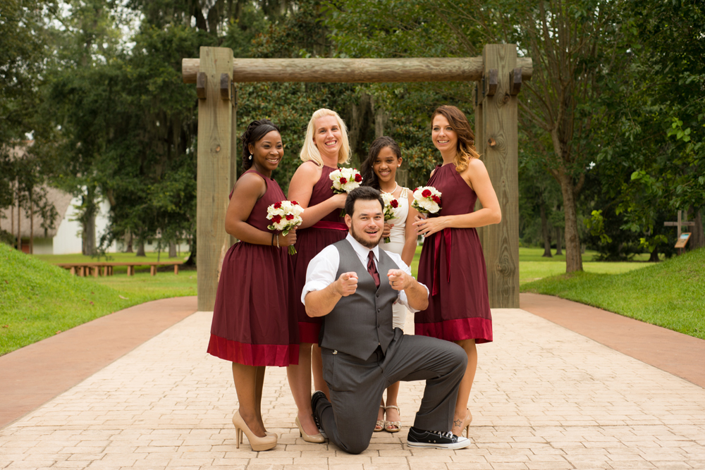 The groom being suave with the bridesmaids