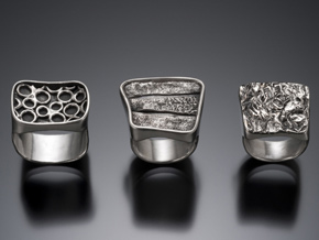 three handmade silver rings
