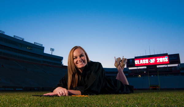 Grad pics at FSU, lying on the field at Doak Campbell stadium