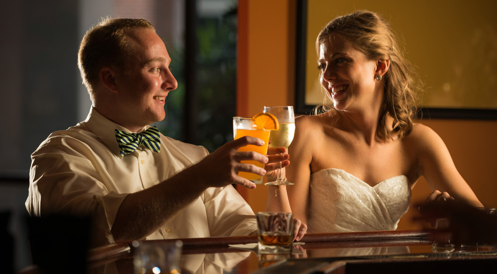 Bride and groom sitting at the bar, having a drink at the DoubleTree in Tallahassee
