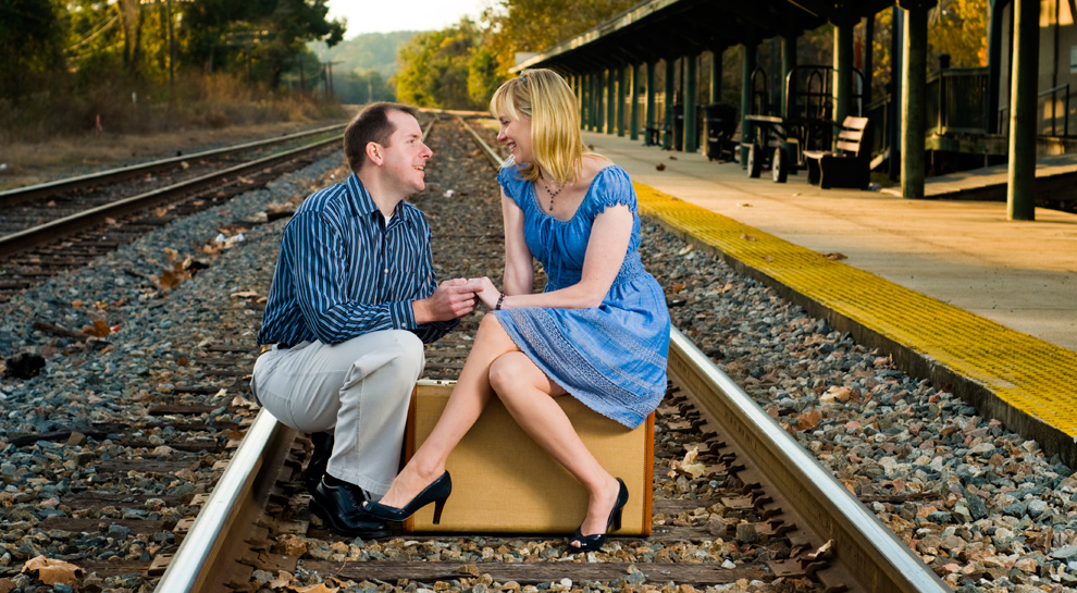 Holding hands while sitting on the train tracks
