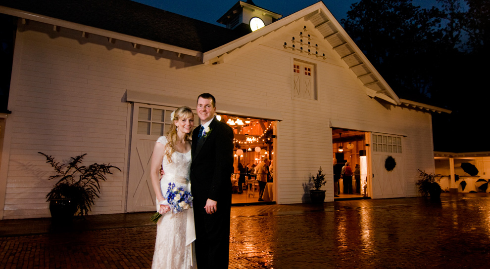 Couple stands outside of the Carriage House at Goodwood in Tallahassee