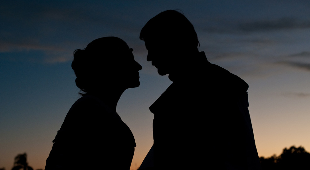 Bride and groom silhouetted against a Florida sunset