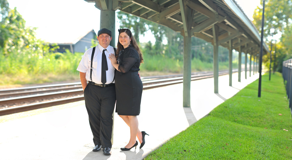 Couple dressed in vintage clothes at a train station in Tallahassee