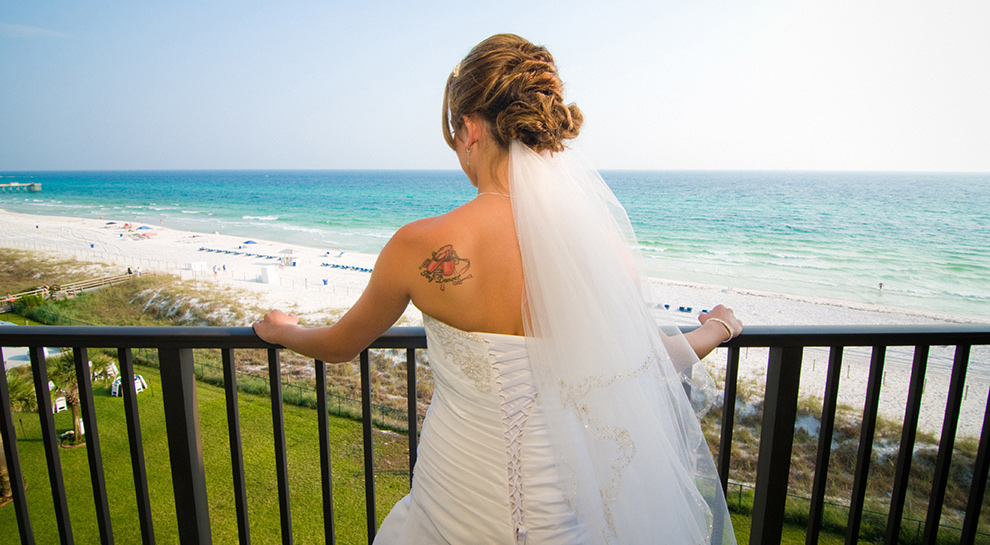 Bride on the balcony at Moonspinner looking over Panama City Beach