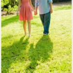 Holding hands, walking together through the park